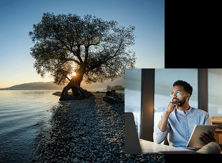 Mann am Computer und See